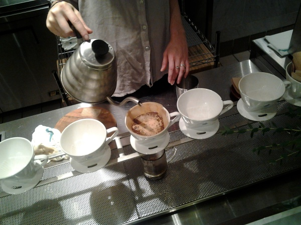 Barista serving a pour over at Blue Bottle, Rockefeller Plaza, Manhattan, N.Y. / March 2013